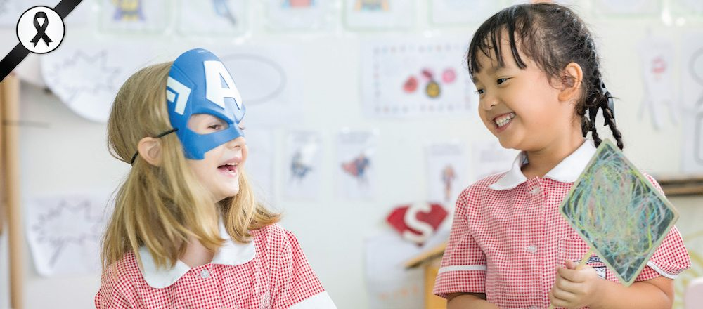 2 girls from Bromsgrove Early Years School laughing